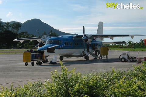 inland flights - small plane on the runway of praslin airport