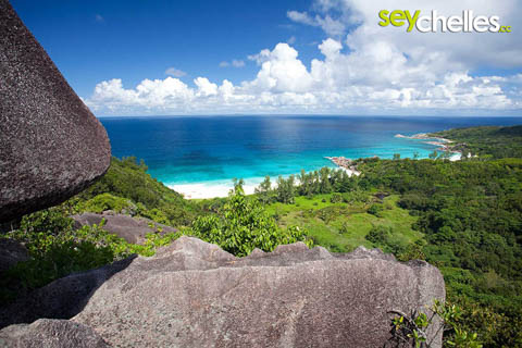 view from the mountains down to grand anse and petite anse on la digue
